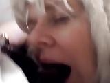 Sexy blonde sucks big black cock