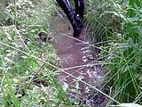 Sexy thigh boots in another mud pit!