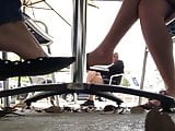 Candid flats dangling under table