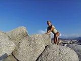 Climbing a Rock in a short Dress