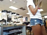 Candid voyeur teen in short shorts shopping