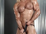 Muscle woman rubs her pussy and big clit