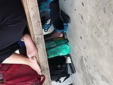 Candid soles by teen girl at the bus station