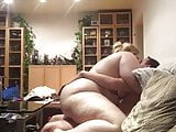 Blonde fat woman fucks on the couch
