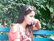 Elizabeth Douglas at park on phone with Sandy Yardish