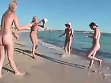 Nude Beach - Four Teens Play Volleyball
