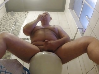 Sitting on the toilet jerking off