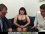 Big boobs mature woman swallows two big cocks