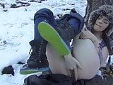 Cutie masturbating in the snow