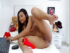 sexy latina strips and plays on webcam