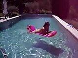 topless girlfriend in pool dancing