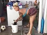 sexy lady dancing while washing clothes