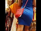 Candid voyeur tall beauty in tight blues dress shopping