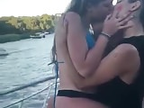 girl caught kiss her friend in public boat party
