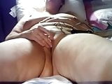 playing with her pussy .........