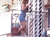 spying neighbour milf with great legs on balcony