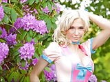 Susan Wayland in cream & pink latex dress