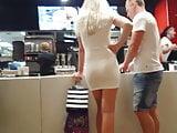 Candid voyeur hot blonde skin tight dress ordering food