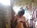 North indian housewife bathing