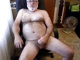 Hairy daddy bear stoking his cock