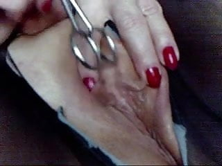 Pandora fucks her big clit and cunt  with her scissors