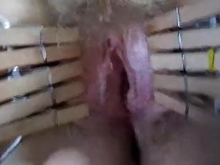 Fucking wife's clothespinned pussy.