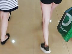 Candid Teen Walking in Black Shorts on the Shoping Center