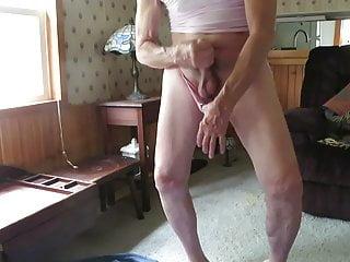 Sissy in pink panties loves to masturbate his...