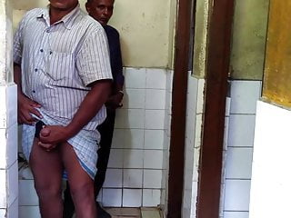 two daddy showing their dick in a toilet Sri Lanka