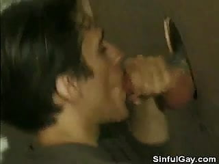 Toilet cubicle cock sucking...