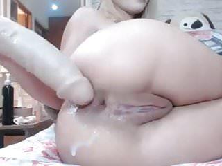 Blonde fucks her elastic ass with huge...