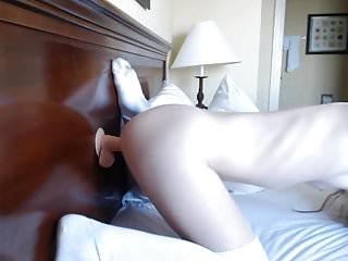 Very beautiful girl having fun with a dildo on the bed