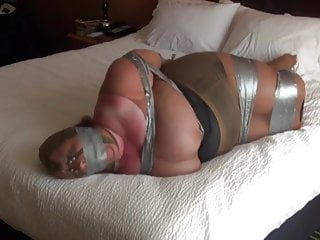 Tits duct taped fully encased in nylon...