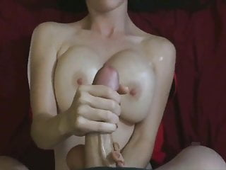 Gets handjob with two hands by busty brunette...