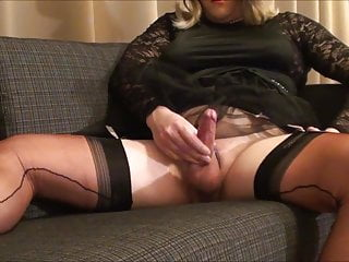 Cumming in black satin dress