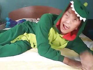 Horny asian guy jacking off wearing furry dinosaur...