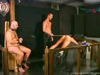 Poor male slaves are caned and waxed one...