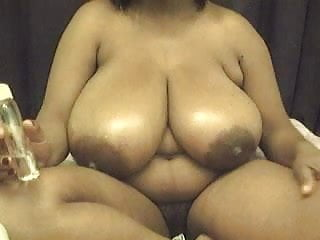 EBONY BBW WITH HUGE TITS PLAYS WITH TITS N PUSSY