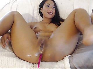 Asian babe using dildo