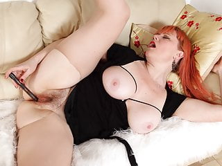English milf Velvetina rips her tights and performs