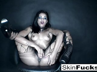 Playing with her tight pussy wearing sexy fishnets