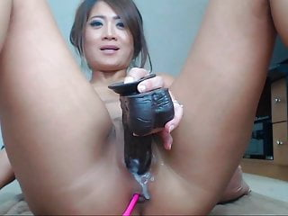 Chinese girl masturbation by big black dildo