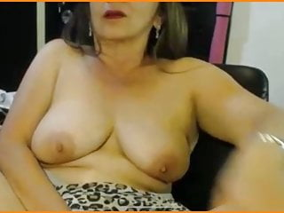 Mature Angela show pussy and tits