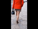 #102 Lady with attractive legs in mini skirt and excessive heels