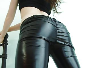Young cutie in tight leather pants strips on camera