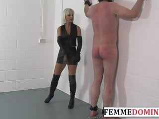 Domina disciplines subject with whip and cane