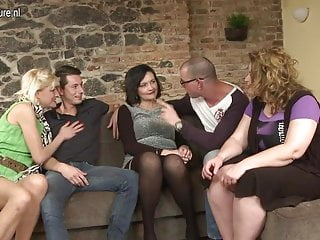 Two guys fucking three mature moms in group...