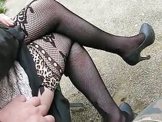 Touching Fishnet stockings outdoor