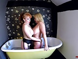 MILF Red and Lucy share a bath and make each other cum