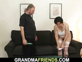 Old granny enjoys two cocks after shaggy pussy toying